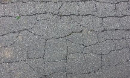 This Asphalt will have to be cut out & replaced